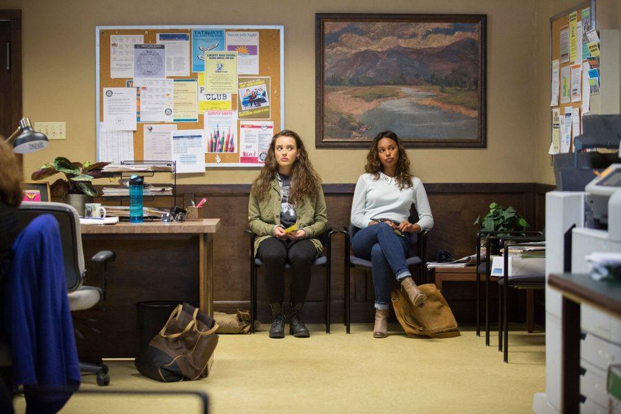 Katherine Langford, left, and Alisha Boe play frenemies in the Netflix series