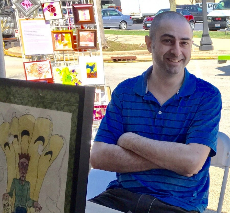 Elijah Griffin at Ebertfest 2016. For Griffin, Ebertfest is an opportunity to draw his colorful, otherworldly art