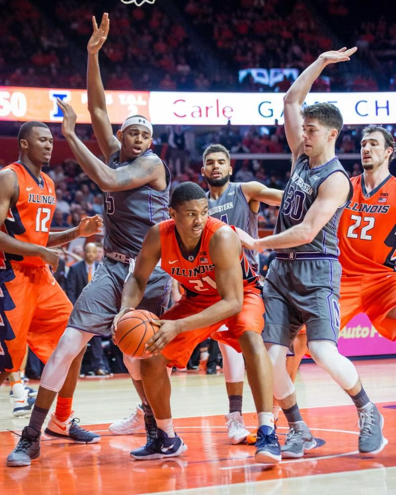 Illinois' Malcolm Hill (21) looks to pass the ball after grabbing a rebound during the game against Northwestern at State Farm Center on Feb. 21.