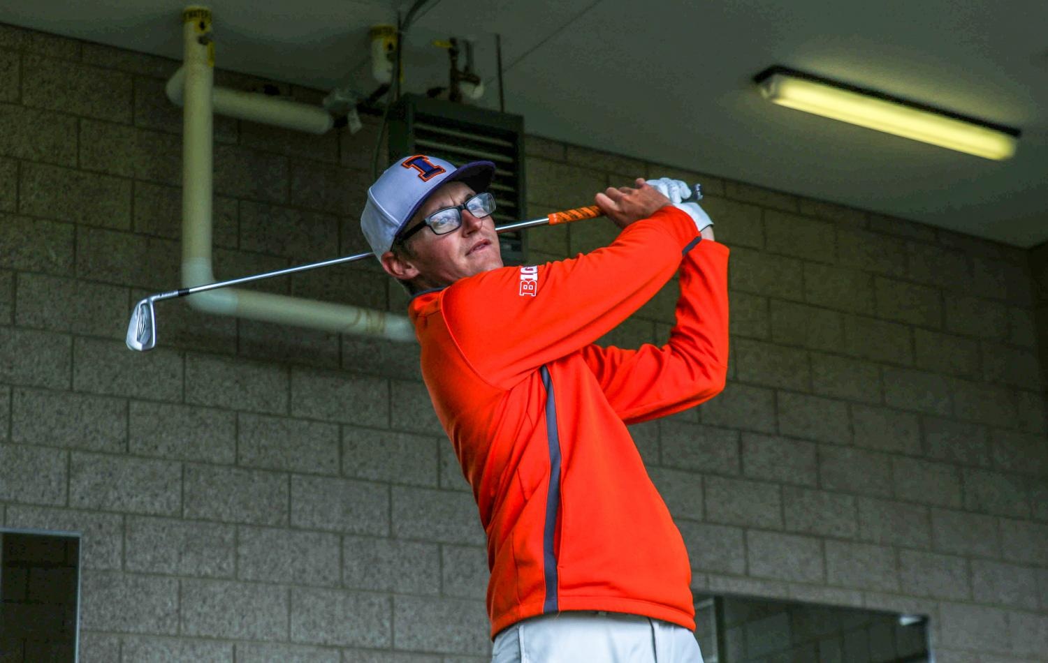 Dylan Meyer takes a practice swing at the Demirjian Golf Practice Facility on April 6. Meyer completed a first-place finish last weekend at theBig Ten Championships.
