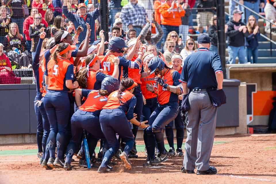 Illinois%E2%80%99+Nicole+Evans+jumps+onto+home+plate+after+hitting+her+52nd+career+home+run%2C+breaking+the+school+record%2C+during+the+game+against+Ohio+State+at+Eichelberger+Field+on+Saturday.+