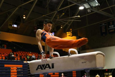 Women lose, men win in gymnastics home openers