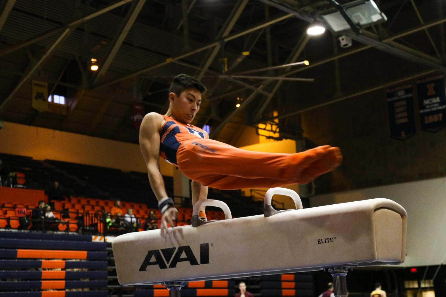 BRIAN+BAUER+The+Daily+Illini%0ABrandon+Ngai+swings+on+the+pommel+horse+in+the+meet+against+Minnesota+at+Huff+Hall+on+Jan.+28.+Illinois+finished+third+at+the+NCAA+championships%2C+with+Ngai+taking+the+pommel+horse+title+with+a+score+of+14.825.