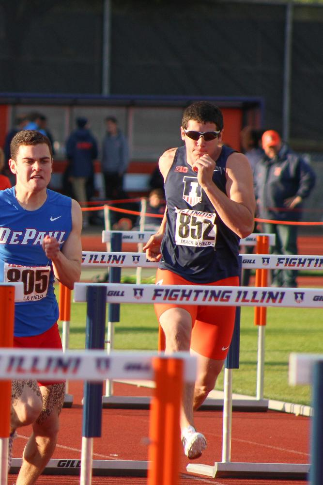 Illinois' Cam Viney jumps a hurdle in the Illini Open meet at the Illinois Track Stadium on Wednesday, May 4.