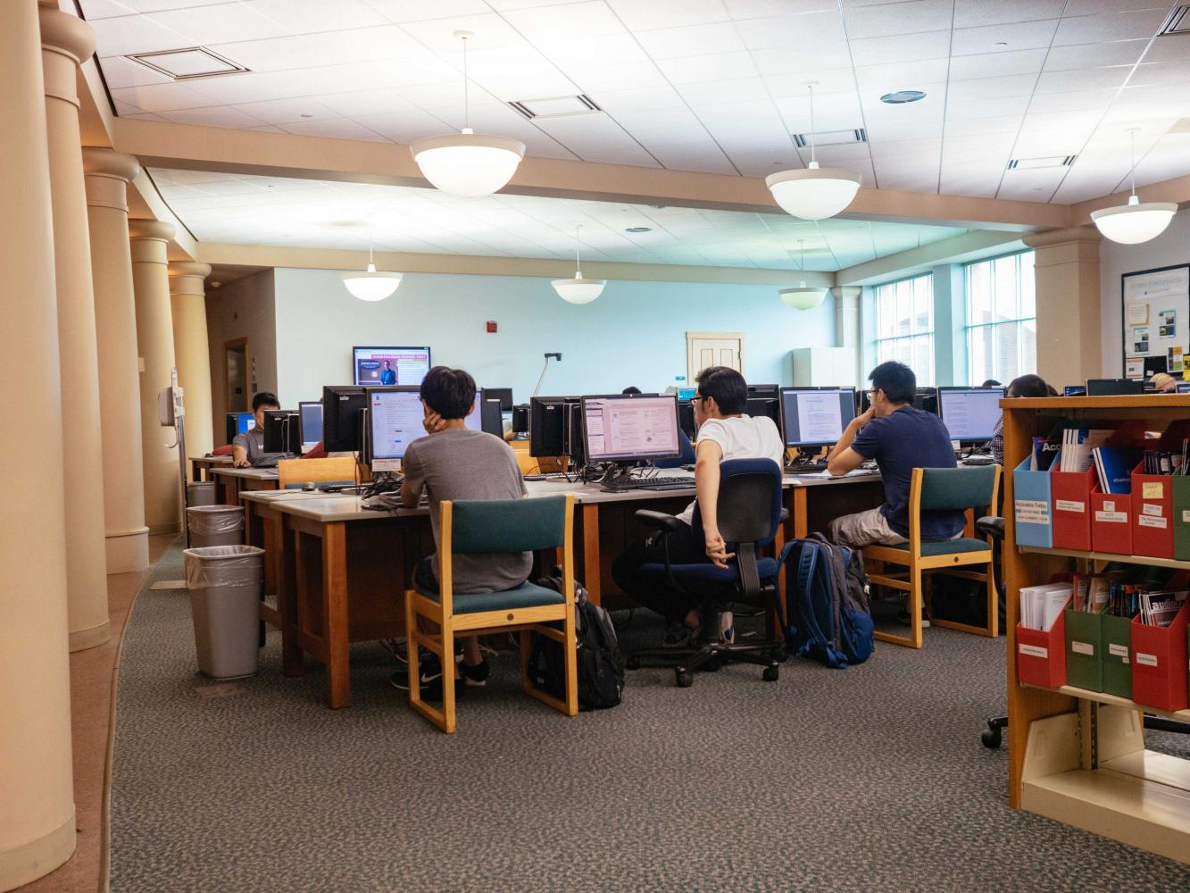 Students study in anticipation for their final exams at Grainger library. Several libraries and other campus locations have expanded their hours and added services, such as therapy dogs, to assist students.