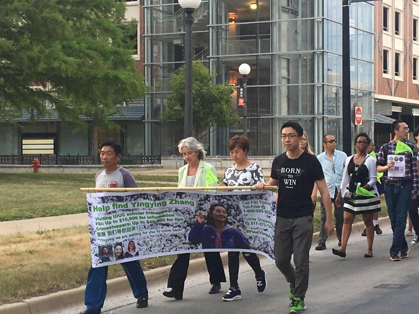 Community+members+walked+to+support+Yingying+Zhang%2C+a+Chinese+visiting+scholar+who+went+missing+on+July+9.+Alleged+kidnapper+Brendt+Christensen+appeared+in+court+today+and+was+not+granted+bond.+