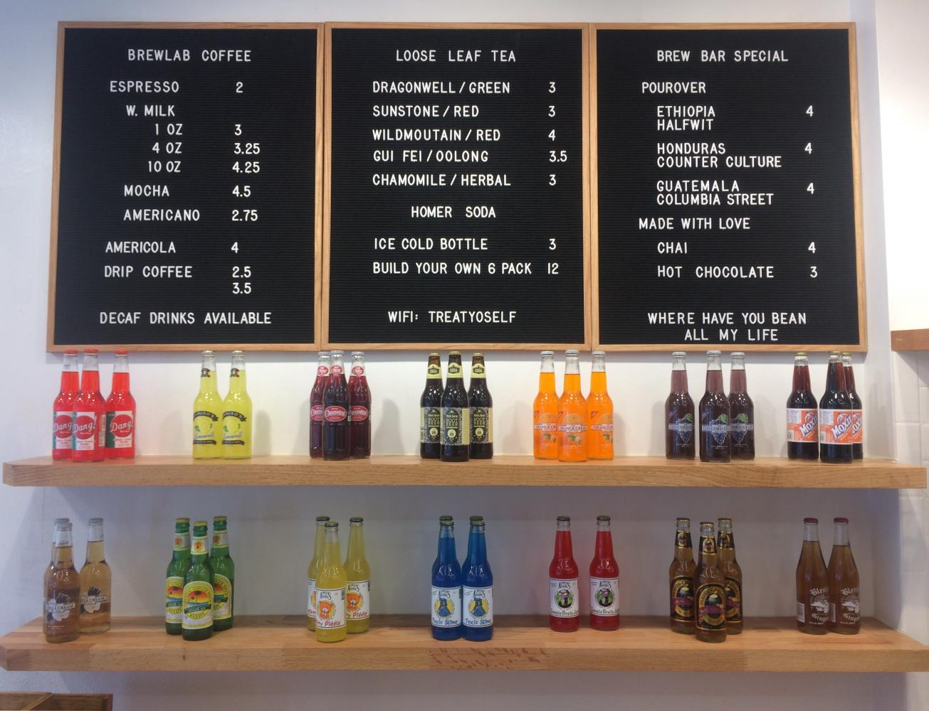 The menu at BrewLab sits above the store's craft soda bottles. BrewLab, recently opened and located in Campustown, serves specialty espresso drinks as well as craft soda.