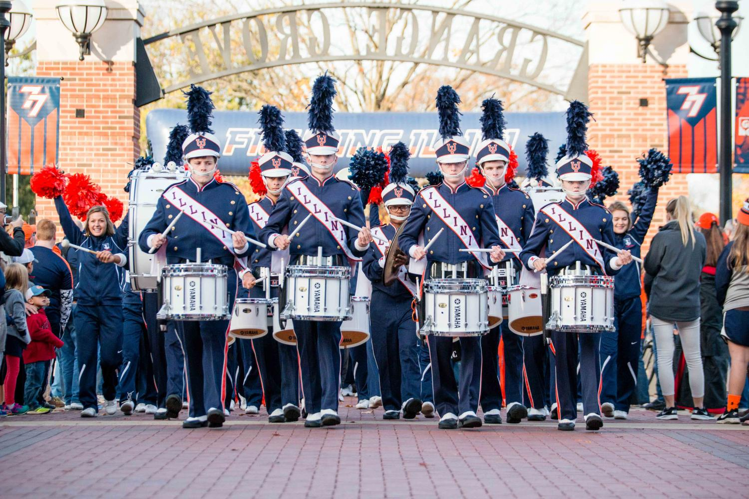 The+Marching+Illini+drumine+leads+the+team+into+grange+Grove+before+the+game+against+Michigan+State+at+Memorial+Stadium+on+Nov.+25%2C+2016%2F+Sports+Editor+Cole+Henke+disputes+the+reasoning+the+University+used+to+retire+the+%22War+Chant.%22