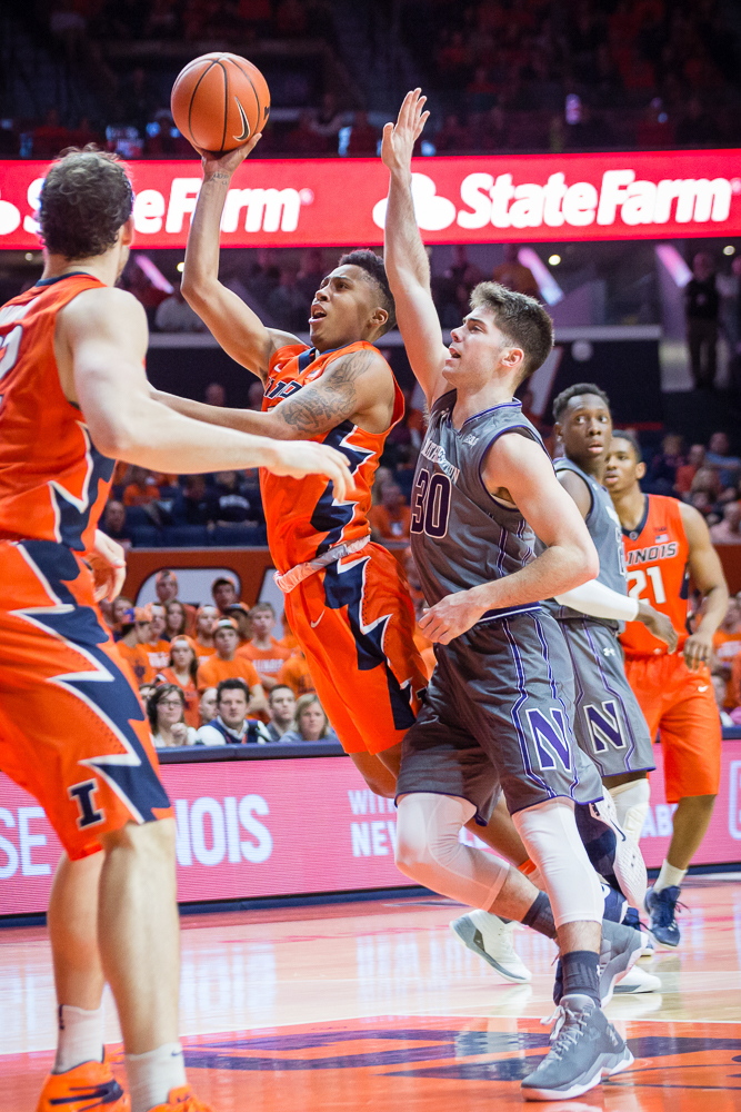Illinois' Te'Jon Lucas (3) puts up a floater during the game against Northwestern at State Farm Center on Tuesday, February 21.