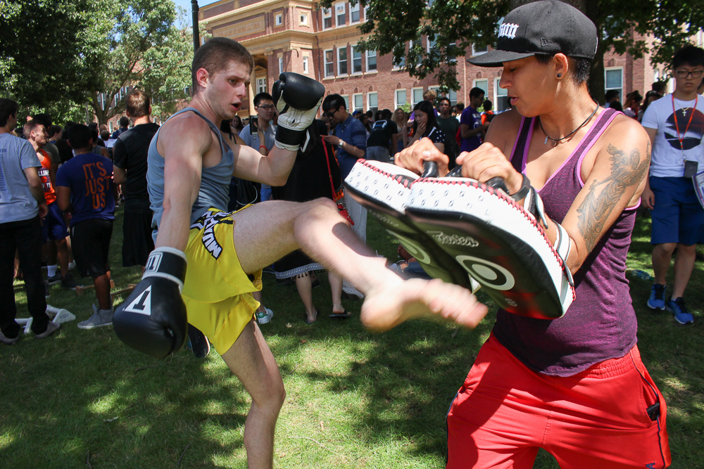 Members of Goshin Jitsu spar on the Main Quad during Quad Day on Sunday, Aug. 21, 2016.