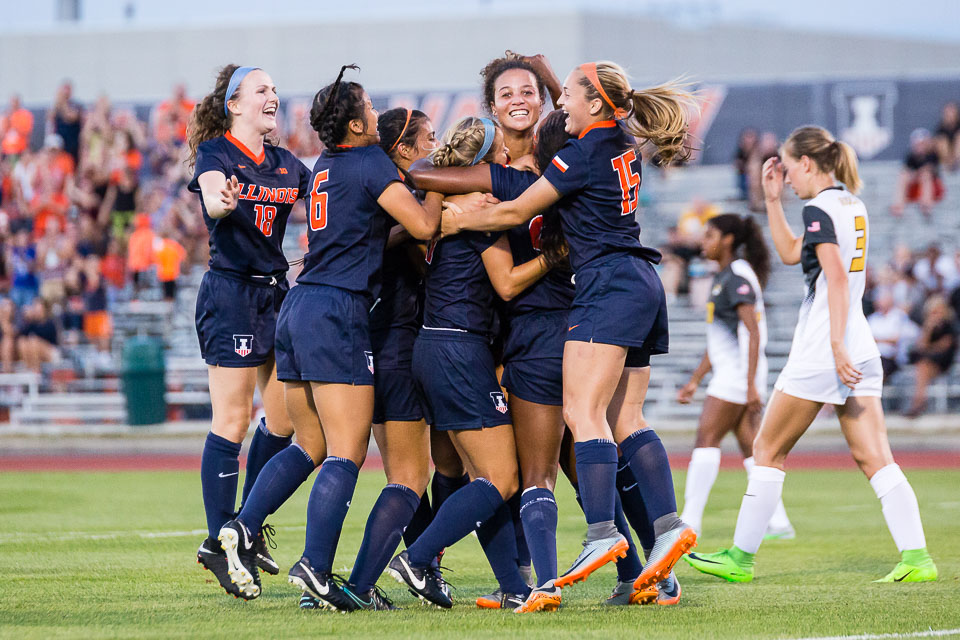 The Illinois socer team gathers around Arianna Veland (right center) after she scored a goal at the end of the first half of the game against Missouri at Illinois Soccer Stadium on Friday, August 18. The Illini lost 3-1.