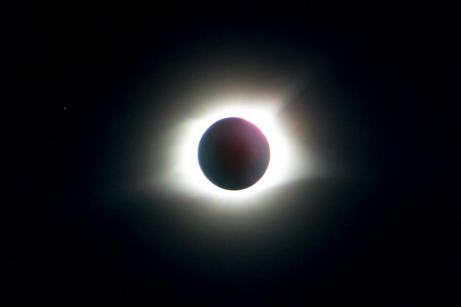 University astronomers have spent the last two year's preparing for Monday's total solar eclipse. While they will be traveling to southern Illinois to witness the most intense changes in the path of totality, 93 percent of the sun in Champaign-Urbana will be eclipsed. The photographed solar eclipse was captured in southern Illinois on Monday, Aug. 21.