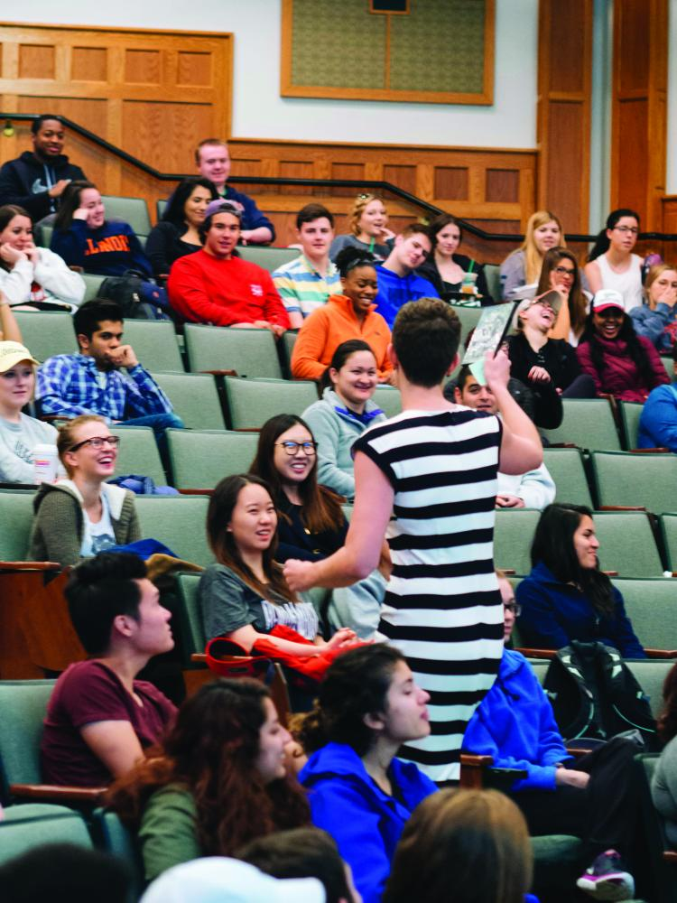 Professor Lena Hann hands out an entertaining prize as her students burst into laughter during her last lecture at Illinois on May 3.