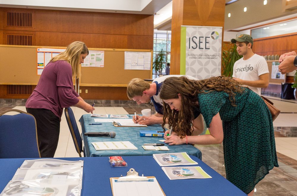 Students signing in for the ISEE Congress 2017 in Alice Campbell Alumni Center on Sep. 18th. The congress this year has a topic of Building Resilience to Climate Change.