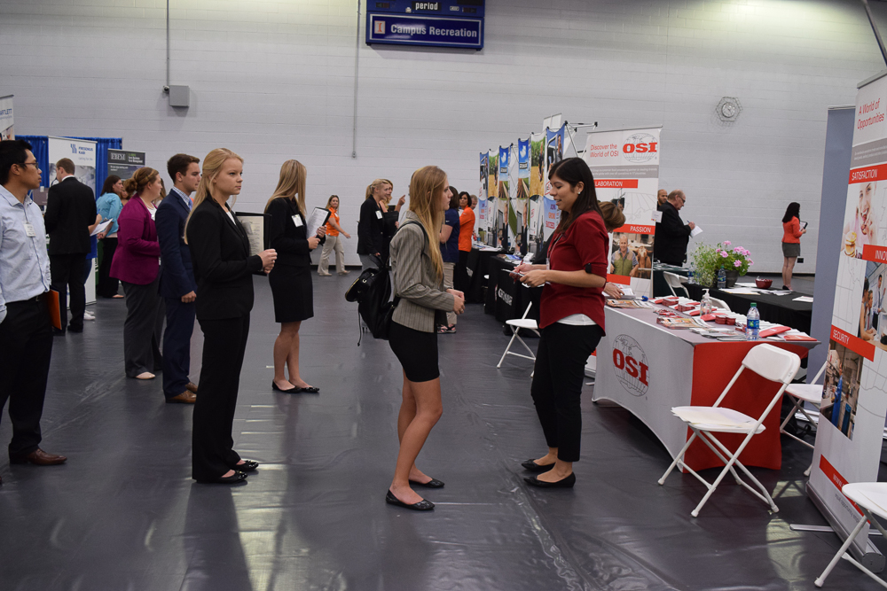 Students Wait Patiently In Line To Talk Potential Employers At The ACES Career Fair