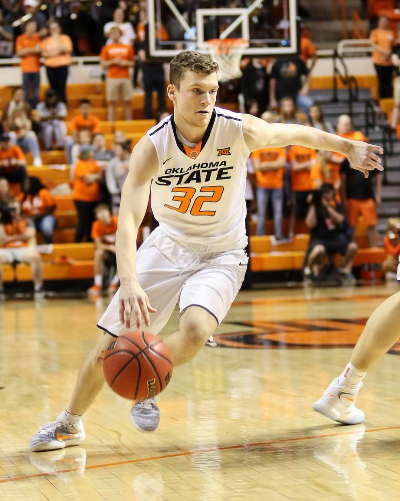Point Guard Tyler Underwood dribbles past a defender during his time at Oklahoma State. Underwood transferred to the University of Illinois after his dad left Oklahoma State to become the new Illini head basketball coach.