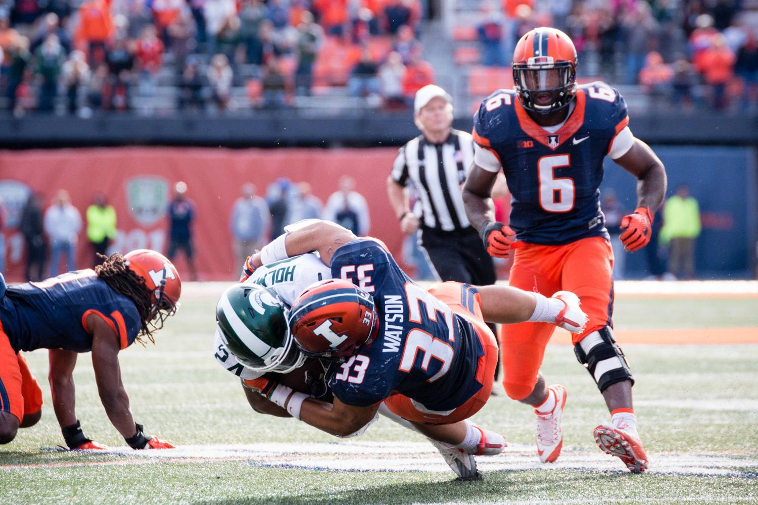 Illinois linebacker Tré Watson (33) tackles Michigan State running back Gerald Holmes (24) during the game against at Memorial Stadium on Saturday, November 5. The Illini won 31-27.