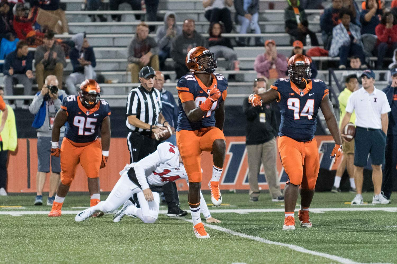 Freshman defensive end Bobby Roundtree celebrates after making a tackle during the Sept. 9 game against Western Kentucky. The Illini won 20-7.