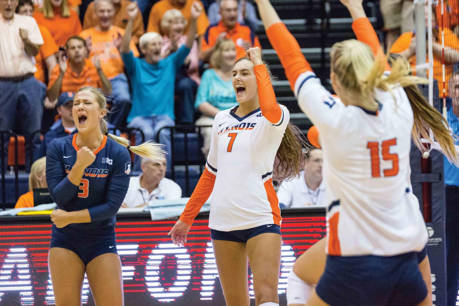 Illinois outside hitter Jacqueline Quade (7) and defensive specialist Brandi Donnelly (3) celebrate during the match against Stanford at Huff Hall on Sept. 8.