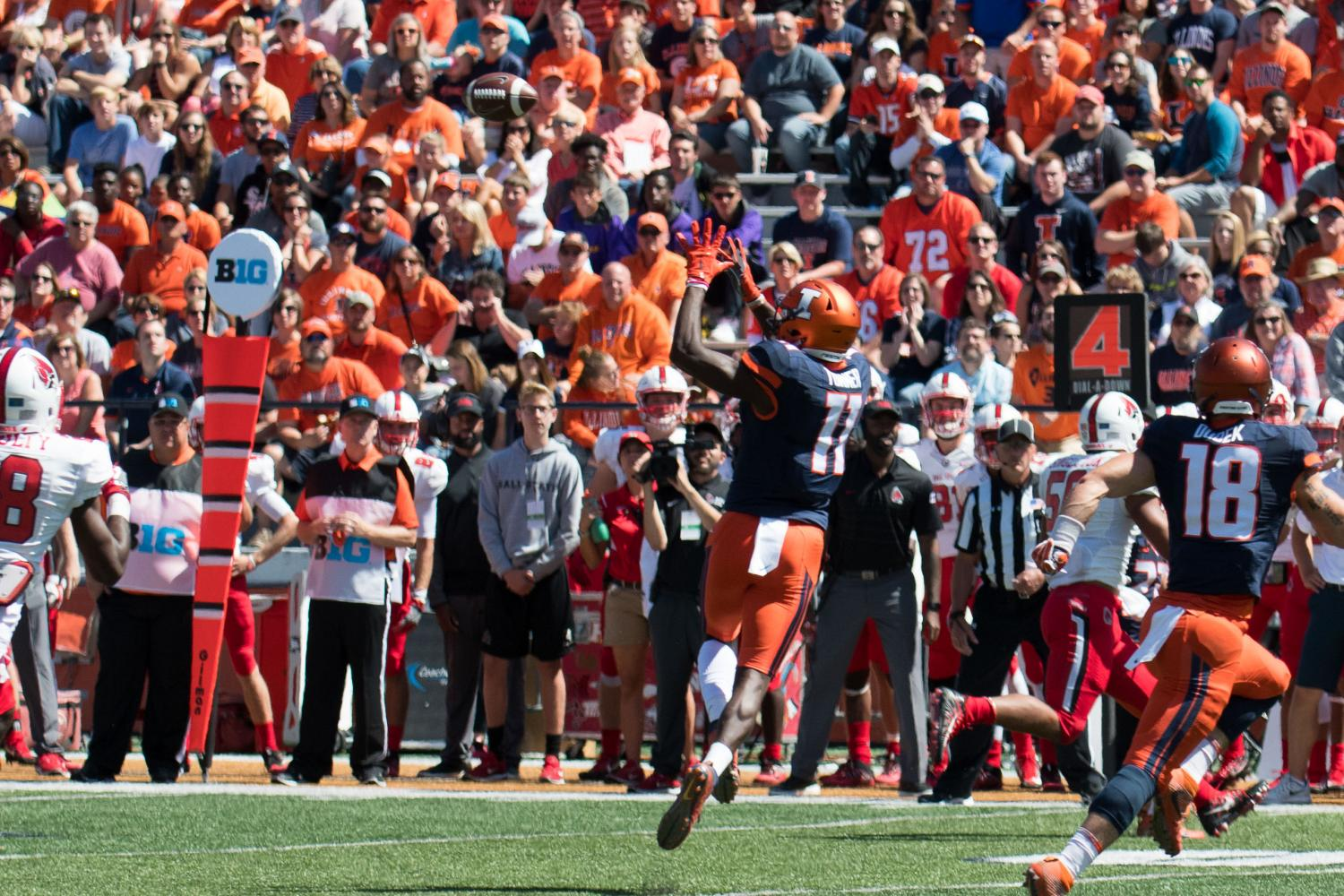 Illinois wide receiver Malik Turner jumps to catch a pass for a successful fourth down conversion during the team's close victory against Ball State on Saturday. The Illini won 24-21.