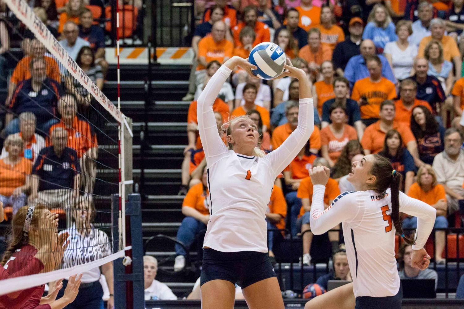Jordyn+Poulter+sets+the+ball+to+Ali+Bastianelli+during+the+match+against+Arkansas+at+Huff+Hall+on+Aug.+26.+The+Illini+won+3-0.+This+season%2C+in+the+Cardinal+Classic%2C+Bastianelli+had+eight+blocks+against+Kent+State.+The+team%27s+record+is+now+6-0.