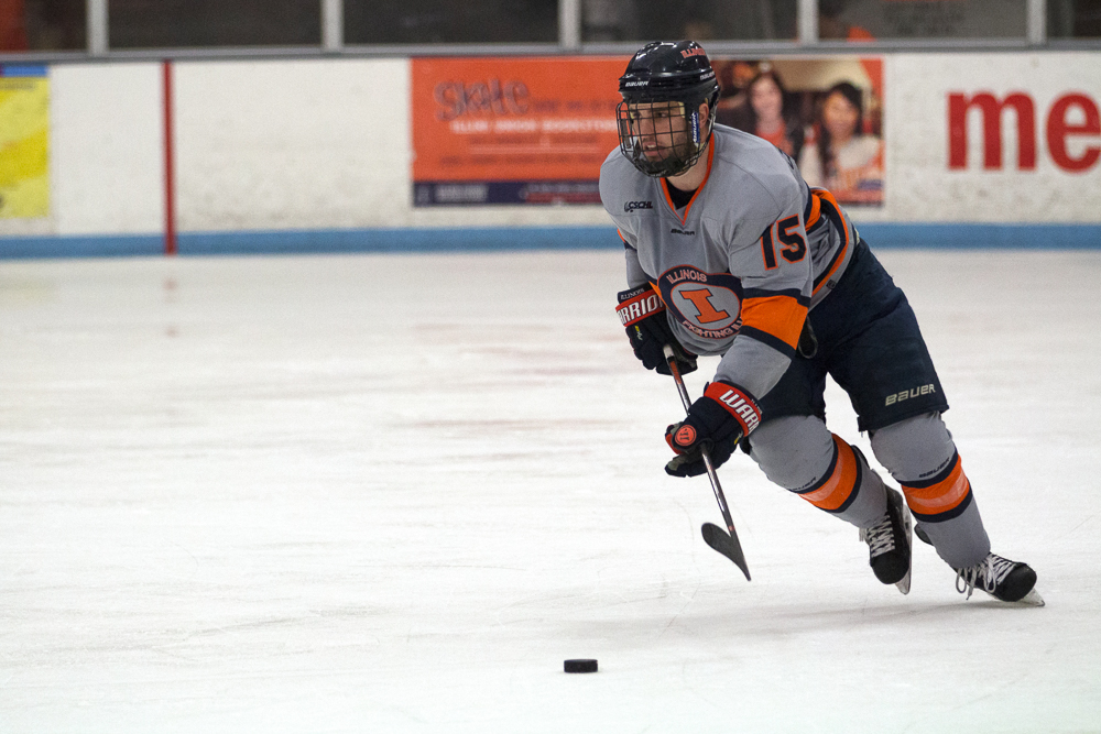 Eric+Cruickshank+%2815%29+gains+possession+of+the+puck+and+takes+it+up+the+ice+to+Robert+Morris%27+zone+at+the+Ice+Arena+on+Saturday%2C+Feb.+18.+Illini+fell+to+Robert+Morris+3-2.