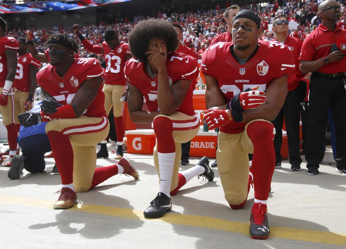 From left, San Francisco 49ers' Eli Harold (58), quarterback Colin Kaepernick (7) and Eric Reid (35) kneel during the national anthem before their NFL game against the Dallas Cowboys on Sunday, Oct. 2, 2016 in Santa Clara, Calif.