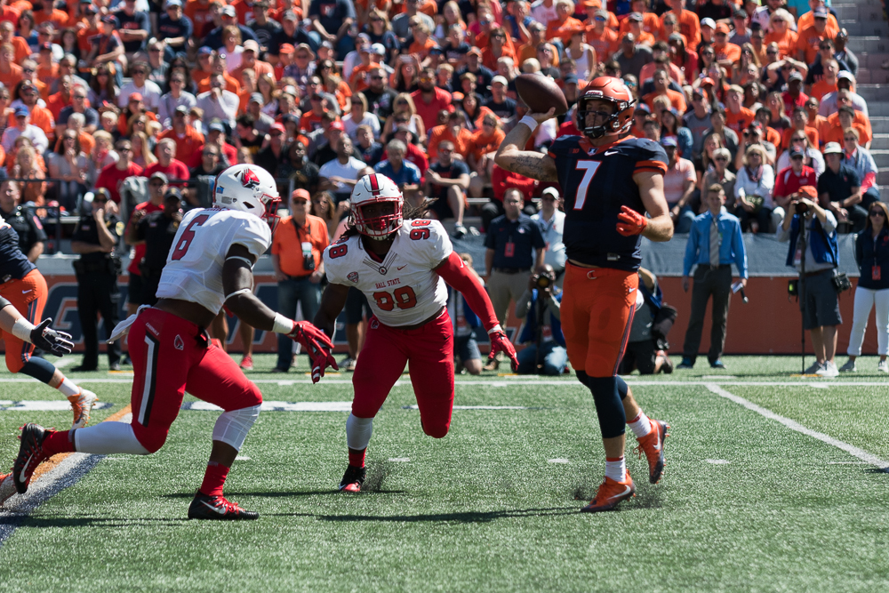 Illinois quarterback Chayce Crouch attempts a pass during the Illini's matchup with the Ball State Cardinals. The Illini won 24-21.