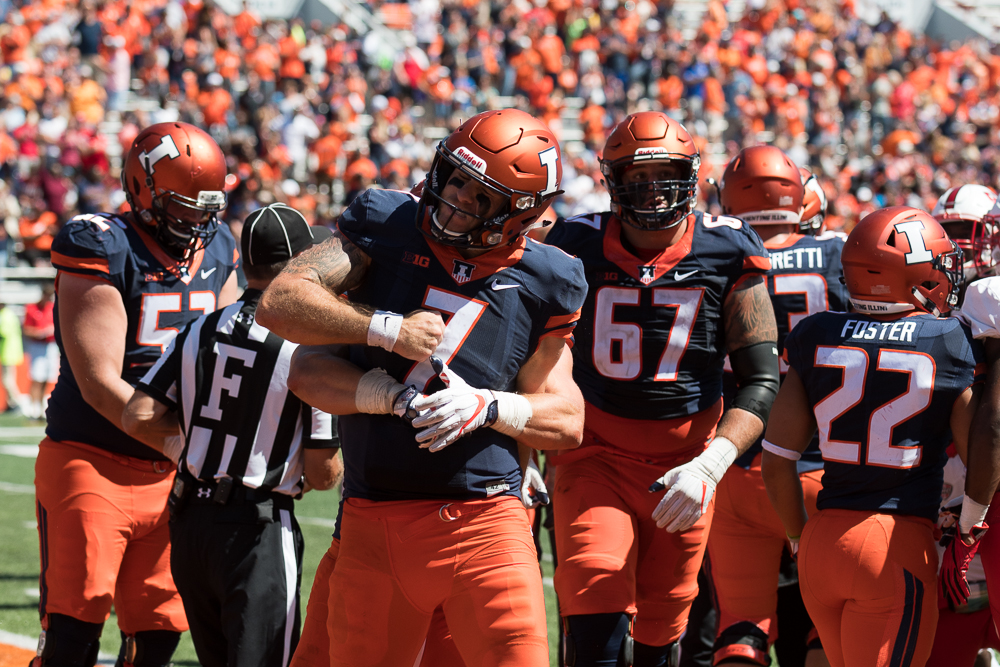 Quarterback Chayce Crouch celebrates with his teammates after completing a two point conversion in the fourth quarter. The Illini won 24-21.