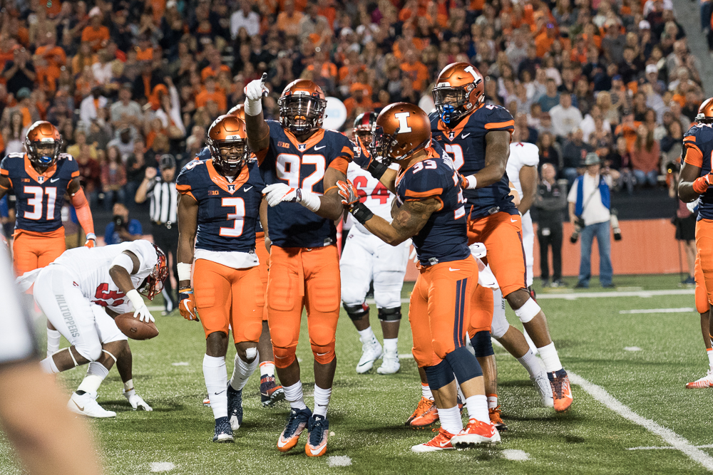 Freshman+defensive+end+Isaiah+Gay+points+to+the+sideline+after+making+a+tackle+against+Western+Kentucky+on+Saturday.+The+Illini+won+20-7.