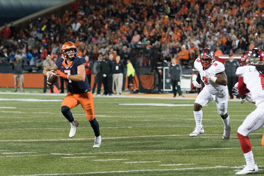 Illinois+quarterback+Chayce+Crouch+is+pursued+by+a+Western+Kentucky+defender+as+he+looks+down+field.+The+Illini+won+20-7.