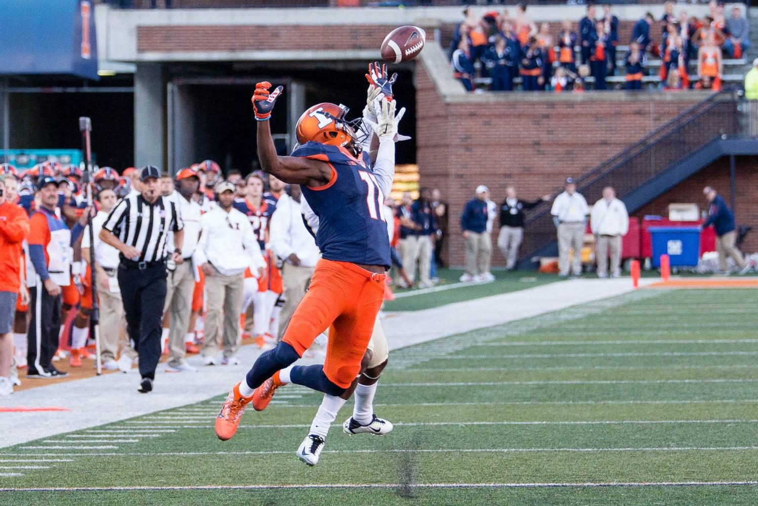 Illinois wide receiver Malik Turner (11) tips a pass that he would later catch during the game against Purdue at Memorial Stadium on October 8. The Illini lost 34-31.