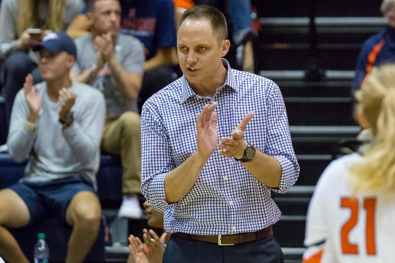 Illinois head coach Chris Tamas claps for his team during the match against Stanford at Huff Hall on Friday, September 8. The Illini lost 3-0.