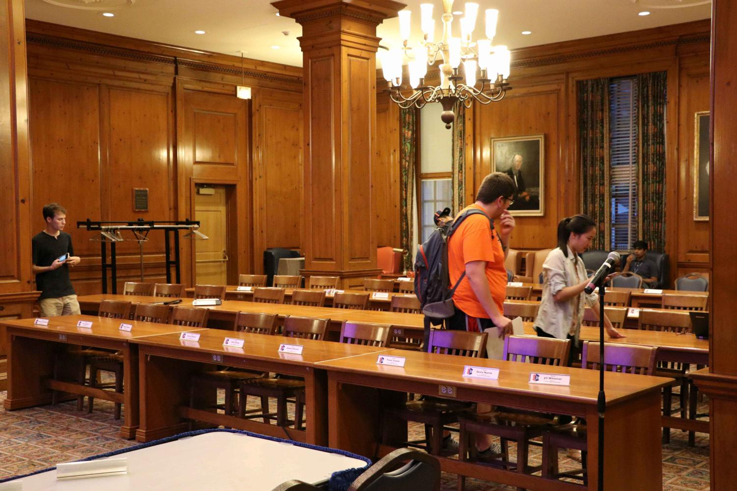 Students setting up name plates for each student senator prior to the meeting.