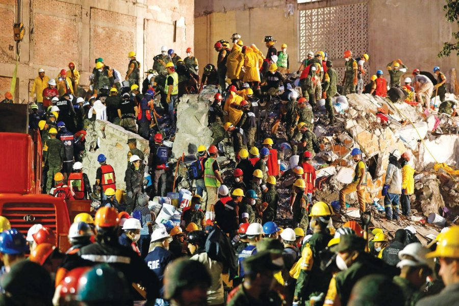 Rescue+teams+working+at+night+continue+to+look+for+people+trapped+underneath+the+rubble+of+a+collapsed+six-story+residential+building+in+Colonia+Condesa%2C+in+Mexico+City%2C+on+Sept.+20.