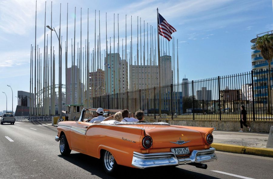 An old car passes in front of the U.S Embassy in Havana, Cuba, on March 17, 2016 prior to a visit by U.S. President Barack Obama.