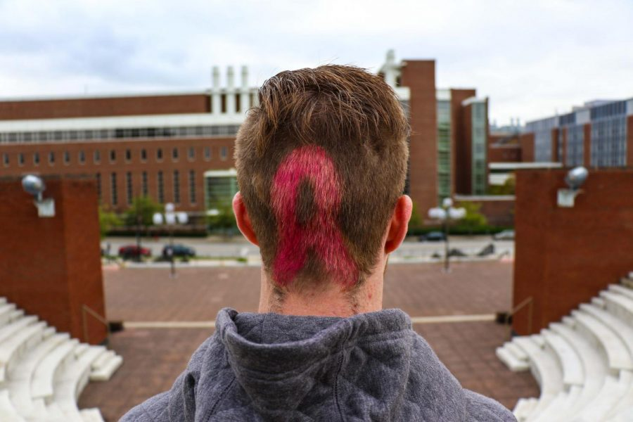 Kevin Troy, sophomore in FAA, has dyed his hair pink in the outline of the breast cancer ribbon every October, which is Breast Cancer Awareness Month, for several years. Troy's mom was diagnosed with breast cancer when he was young, and she died a little over a year ago.