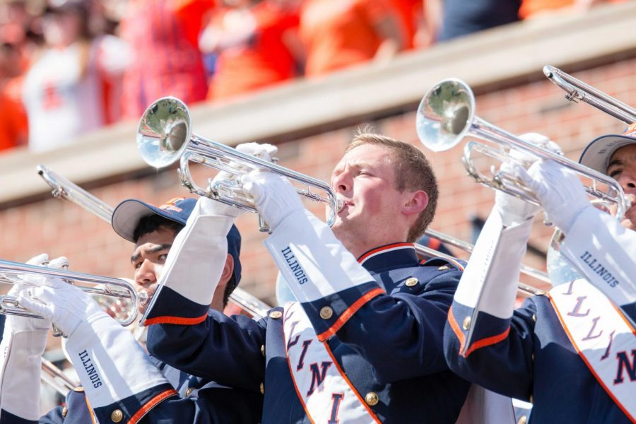 A+trumpet+player+in+the+Marching+Illini+plays+a+song+between+downs+during+the+game+against+Murray+State+at+Memorial+Stadium.+