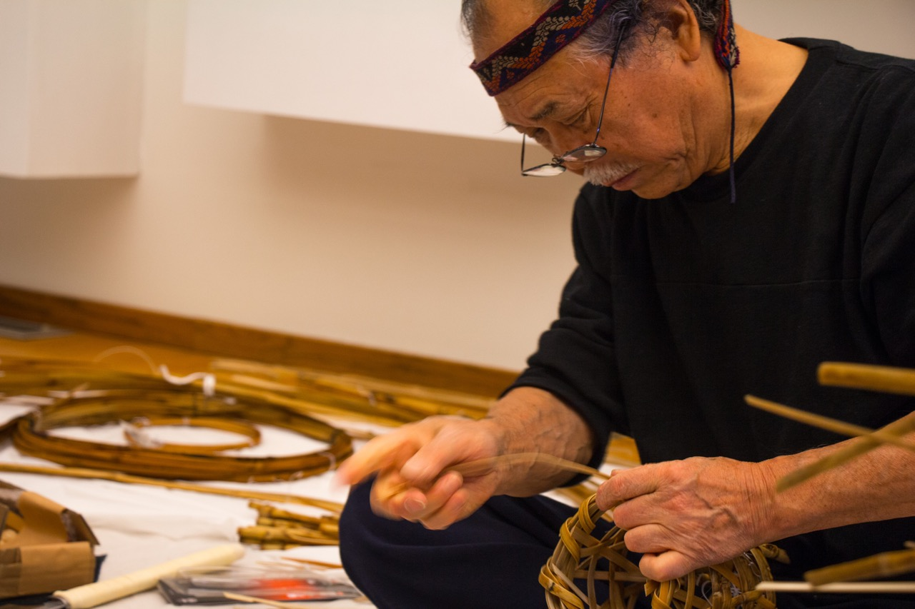 Noboru Fujinuma, a renowned contemporary basket artist, creates a chabana container used for flowers during a tea ceremony at the Japan House on Oct. 24. Fujinuma is a Living National Treasure of Japan, meaning he is certified as a preserver of important, intangible, cultural properties.