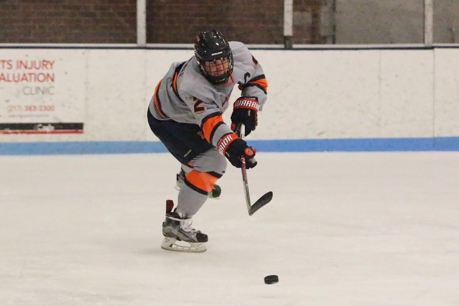 Joey Ritondale (2) passes the puck across the ice to a teammate at the Ice Arena on Friday, Feb. 10. Illini beat Ohio 5-4.