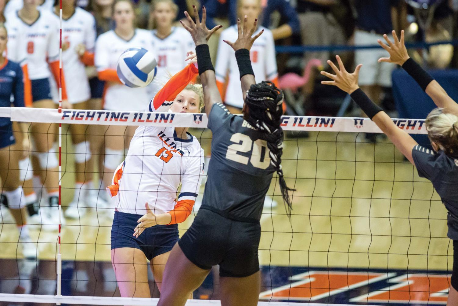Illinois outside hitter Megan Cooney (15) hits the ball during the match against Purdue at Huff Hall on Friday, October 6. The Illini lost 3-0.