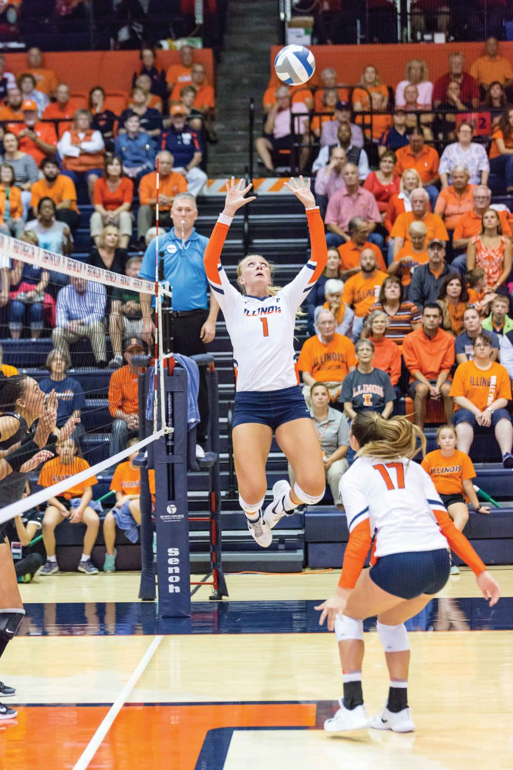 Illinois setter Jordyn Poulter (1) jumps up to set the ball during the match against Purdue at Huff Hall on Friday, October 6. The Illini lost 3-0.