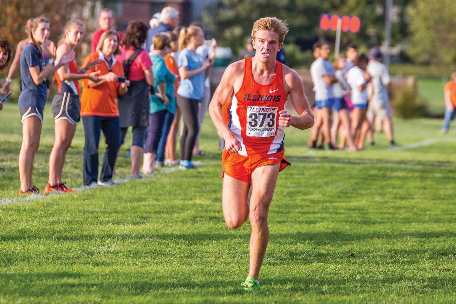 Illinois' Joe Cowlin (373) runs in the Illini Open at the University of Illinois Arboretum on Friday, Oct. 20. Cowlin placed twelfth with a time of 26:49.4 in the men's 8K.