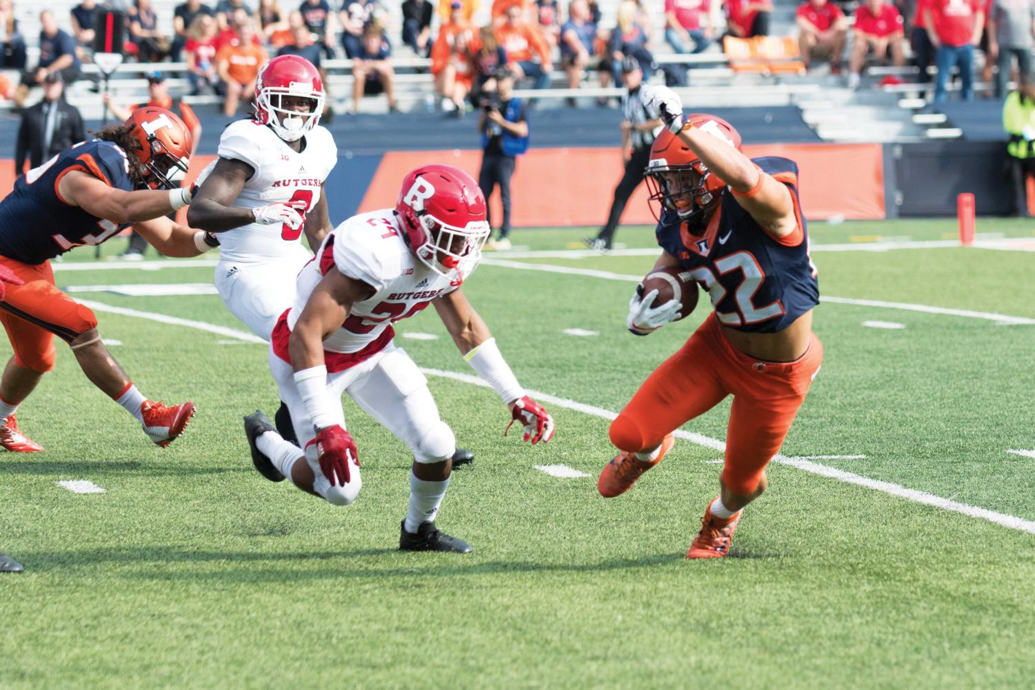 Illinois running back Kendrick Foster dodges defenders during the game against Rutgers on Oct. 24. Although Illinois lost to Wisconsin 35-24, Kendrick Foster intends to make the most of his last season as an Illini football player and take advantage of every opportunity.