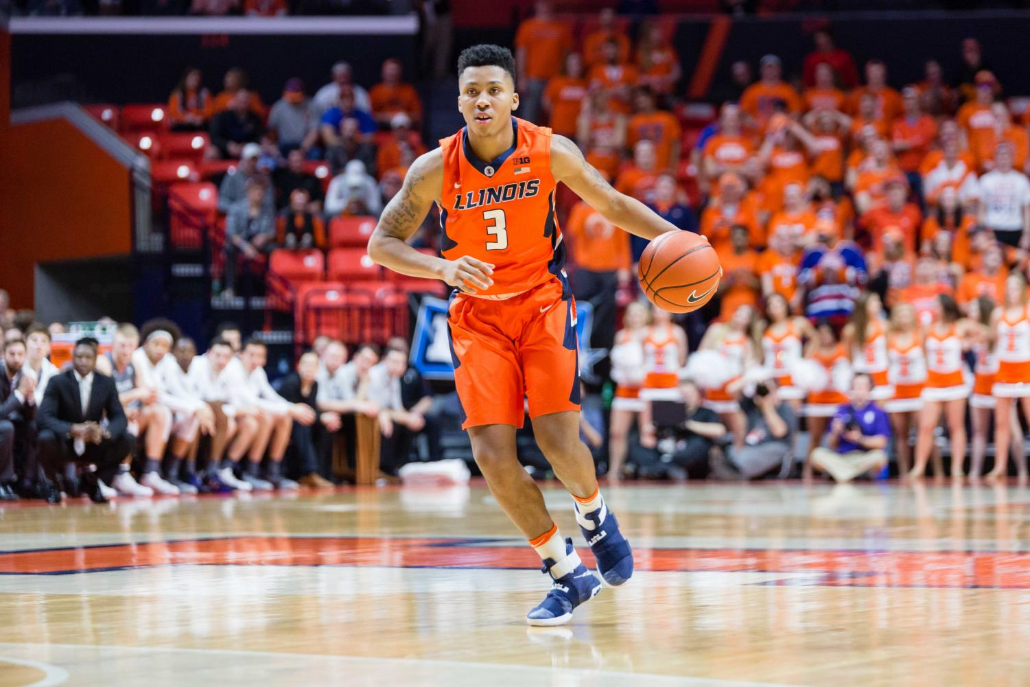 Illinois' Te'Jon Lucas (3) brings the ball up the court during the game against Northwestern at State Farm Center on Tuesday, February 21.