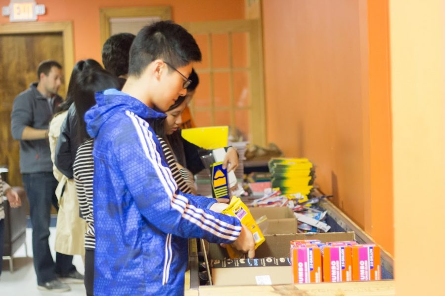 Students organizing school supplies on Oct. 27, 2017 before they are boxed and sent to Syrian refugees.