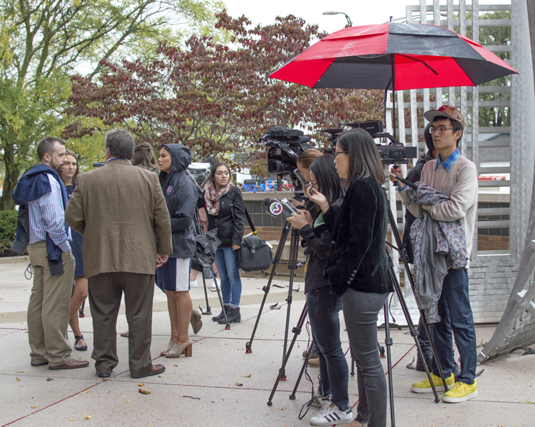 Members of various media outlets wait outside the Champaign County Federal Courthouse immediately following Brendt Christensen's arraignment on Oct. 11. Christensen was charged with one count of kidnapping resulting in death and two counts of making false statements to the FBI.