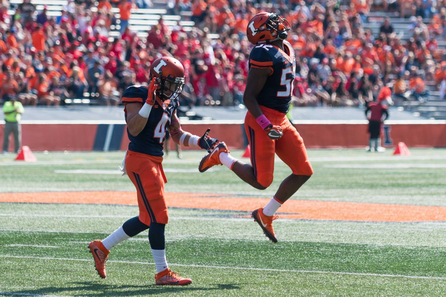 Illinois linebacker Ayo Shogbonyo celebrates a fumble recovery during the game against Rutgers on Oct. 24.  Illinois has had a total of four players ejected for targeting during four separate games this season.