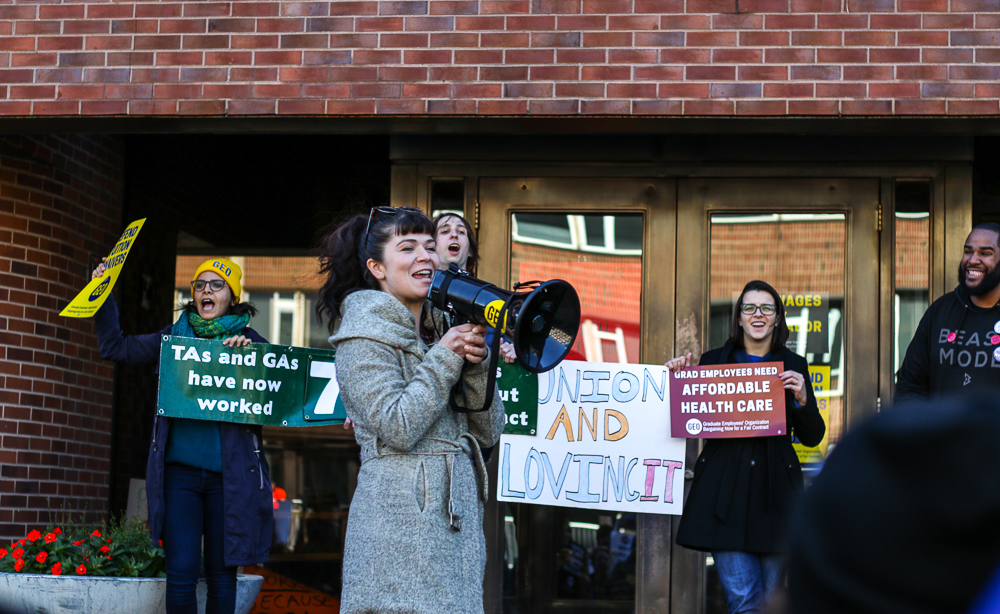 Christina De Angelo, instructor in the Department of Spanish and Portuguese, speaks at the Graduate Employees' Organization protest in front of the Swanlund Administration Building on Thursday.