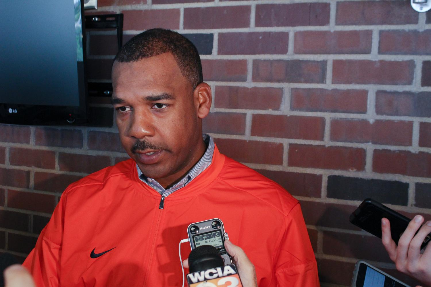 Illinois assistant coach Garrick McGee answers questions at a press conference at Memorial Stadium this Monday.